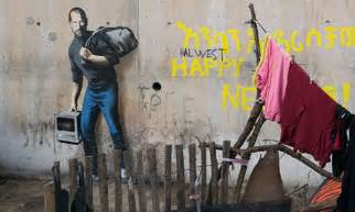 Banksy paints Apple's Steve Jobs carrying an early
